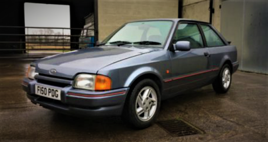 1988 Ford Escort: No photos exist of the car owned by Tommy Quirk, this car is a close copy.